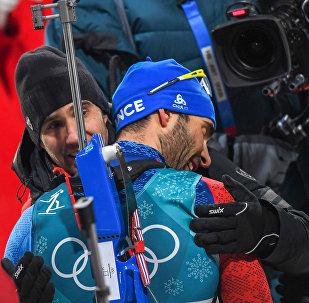 Ֆրանսիացի բիաթլոնիստ Մարտեն Ֆուրկադը 23–րդ ձմեռային Օլիմպիադայում 4–րդ ոսկե մեդալը նվաճելուց հետո (2018թ. փետրվարի 18), Փհենչհան